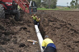 Installing irrigation pipe